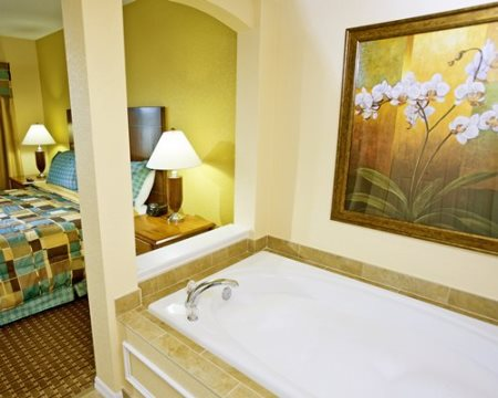 Vacation village at parkway master bedroom with whirlpool tub